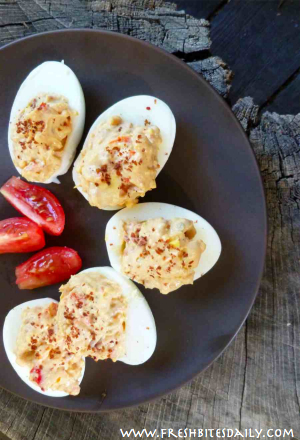 These deviled eggs capture the flavor of flavor of summer, tomatoes, peppers, heaven...