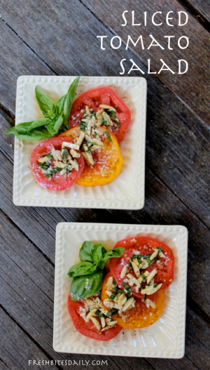 Simply Stunning Sliced Tomato Salad at FreshBitesDaily.com